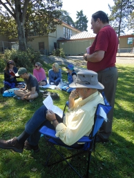 Writers listening to readings in the shade, Rock of Pages Literary Picnic, July 2014
